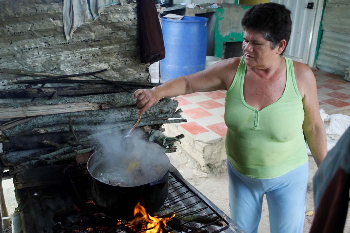 Margarita Rojas cooks the meal using firewood at her house in San Cristobal, Venezuela August 5, 2017. Picture taken August 5, 2017. REUTERS/Luis Parada