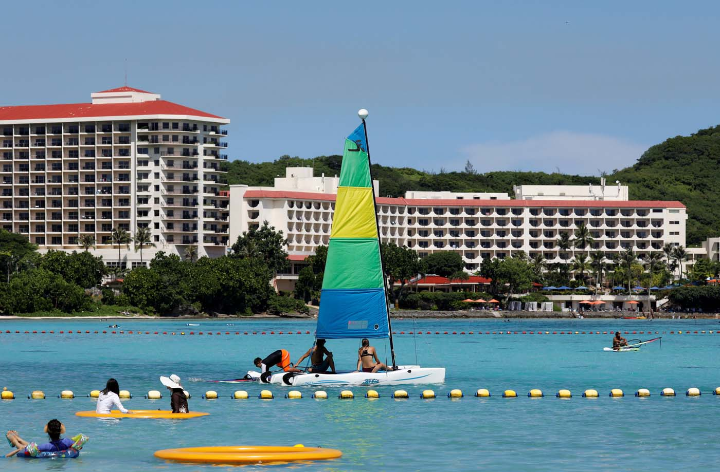 Tourists are pictured on the waters off Tumon beach near Hilton Hotel on the island of Guam, a U.S. Pacific Territory, August 11, 2017. REUTERS/Erik De Castro