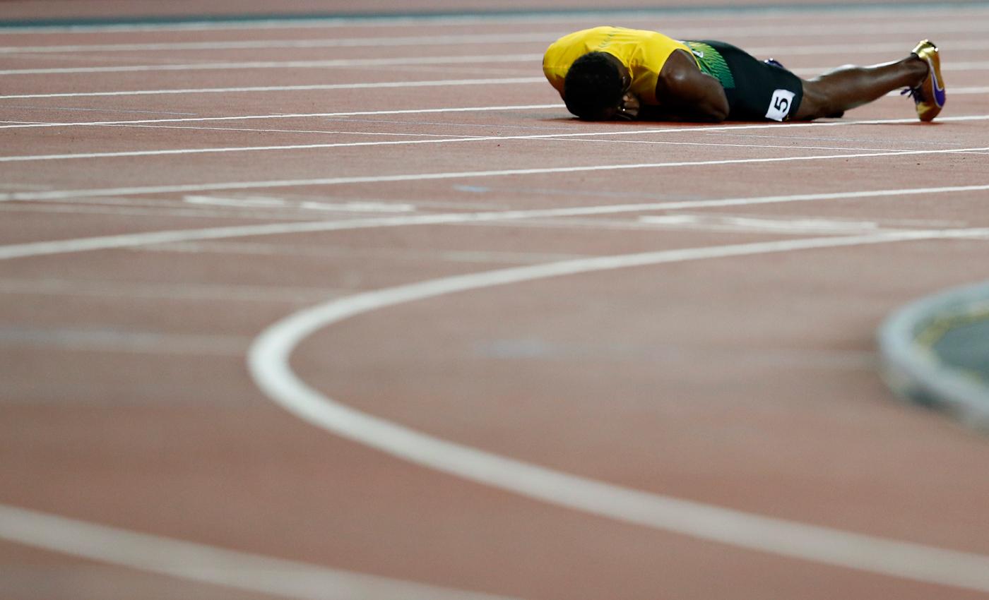 Atletismo - Campeonato Mundial de Atletismo - Final Posta Masculina 4x100 Metros - Estadio de Londres, Londres, Reino Unido – 12 de agosto, 2017. Usain Bolt de Jamaica reacciona después de la final. REUTERS/Phil Noble