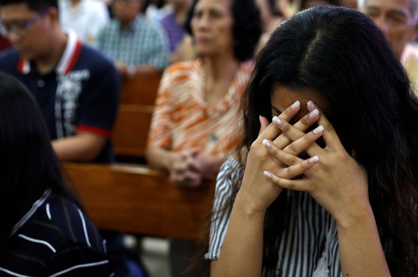 Local residents pray during a Sunday mass at Sta Barbara Church on the island of Guam, a U.S. Pacific Territory, August 13, 2017.  REUTERS/Erik De Castro