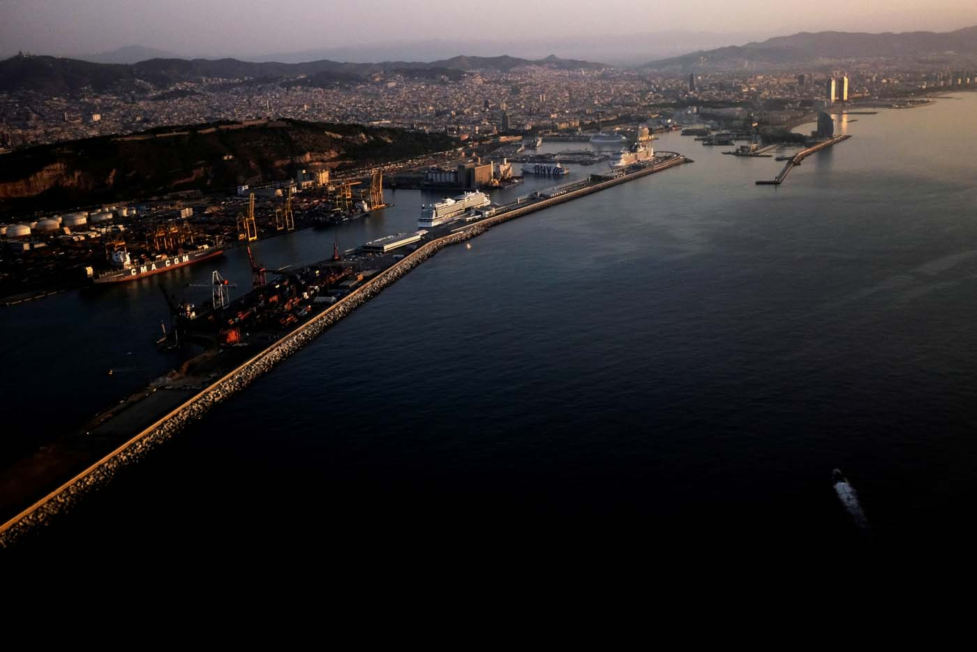 The coast of Barcelona is seen at sunrise the morning after Islamic State claimed responsibility for a vehicle attack on the city's Las Ramblas street in Barcelona, Spain August 18, 2017. REUTERS/James Lawler Duggan