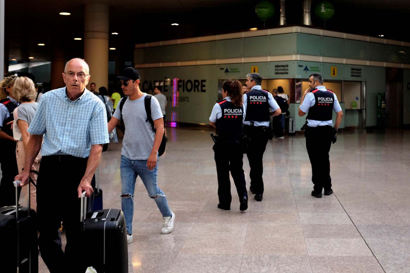 Spanish police patrol Barcelona El Prat airport the morning after Islamic State claimed responsibility for a vehicle attack on the city's Las Ramblas street in Barcelona, Spain August 18, 2017. REUTERS/James Lawler Duggan