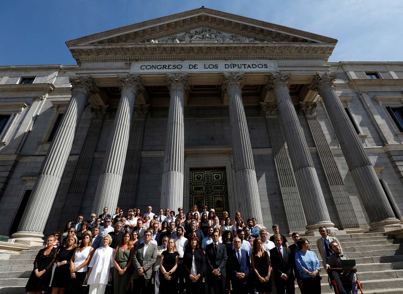 Spanish parliamentarians observe a minute of silence a day after a van crashed into pedestrians at Las Ramblas, outside parliament in Madrid, Spain August 18, 2017. REUTERS/Juan Medina