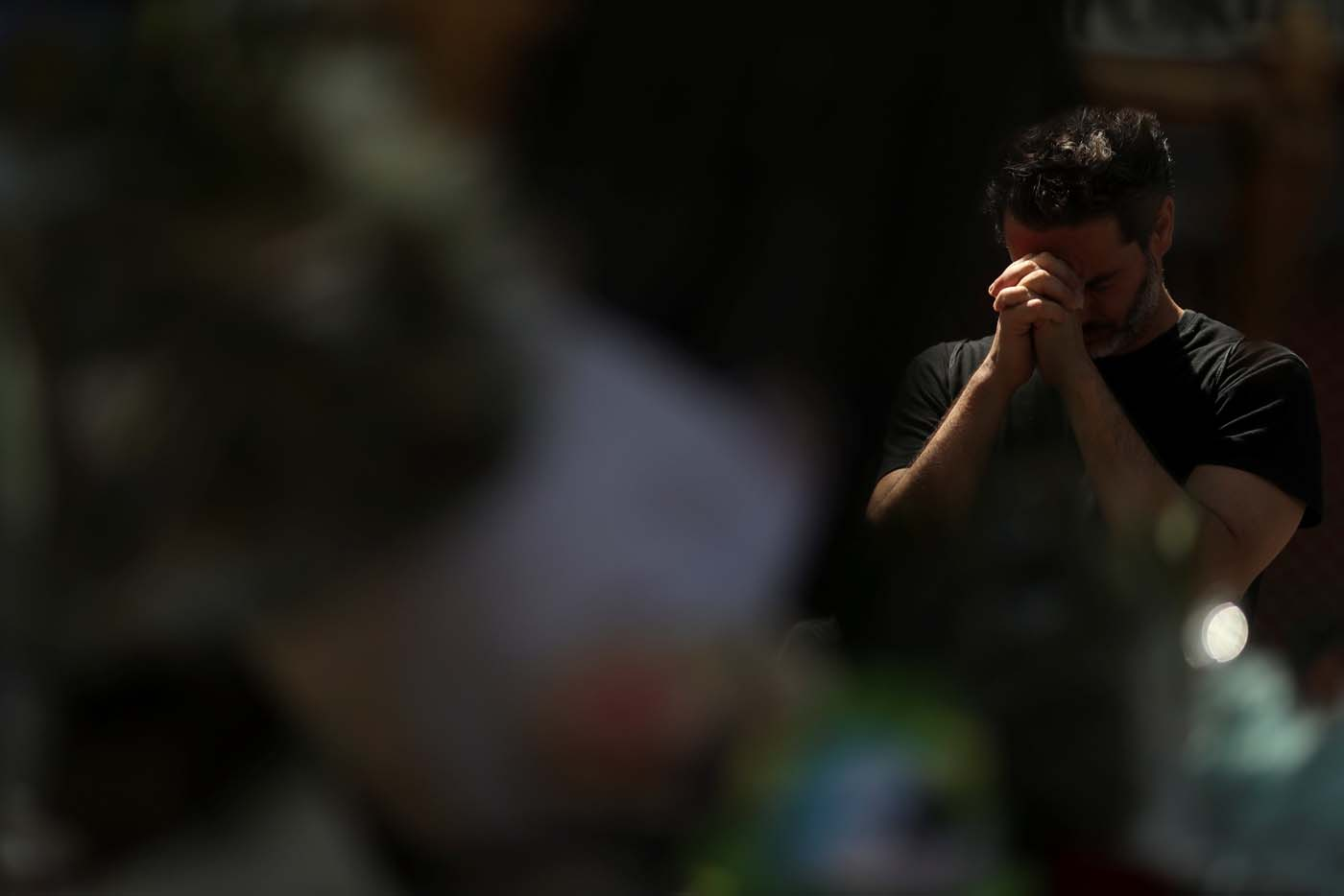 A man reacts at an impromptu memorial a day after a van crashed into pedestrians at Las Ramblas in Barcelona, Spain August 18, 2017. REUTERS/Susana Vera