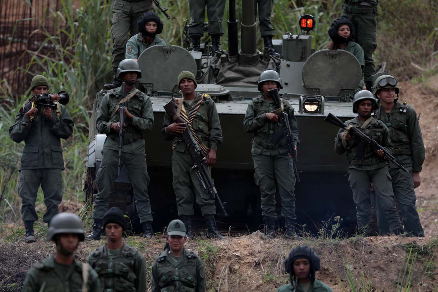 Members of the National Bolivarian Armed Forces attend a news conference by Admiral-in-Chief Remigio Ceballos, Strategic Operational Commander of the Bolivarian National Armed Forces, during military exercises at Fuerte Tiuna Military Base in Caracas, Venezuela August 25, 2017. REUTERS/Marco Bello
