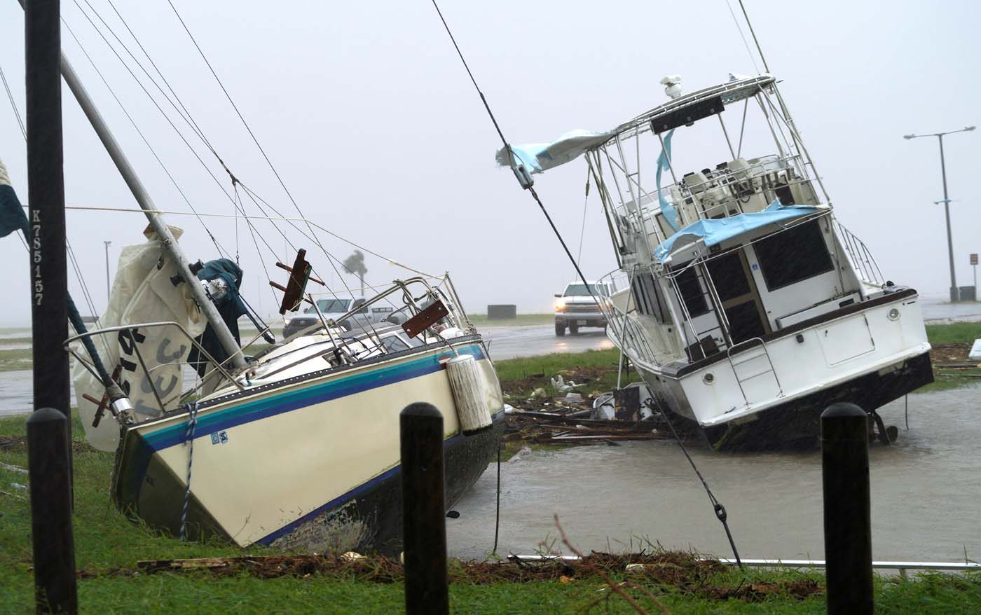 Boats are pushed ashore by Hurricane Harvey in Port Lavaca, Texas, August 26, 2017. REUTERS/Rick Wilking