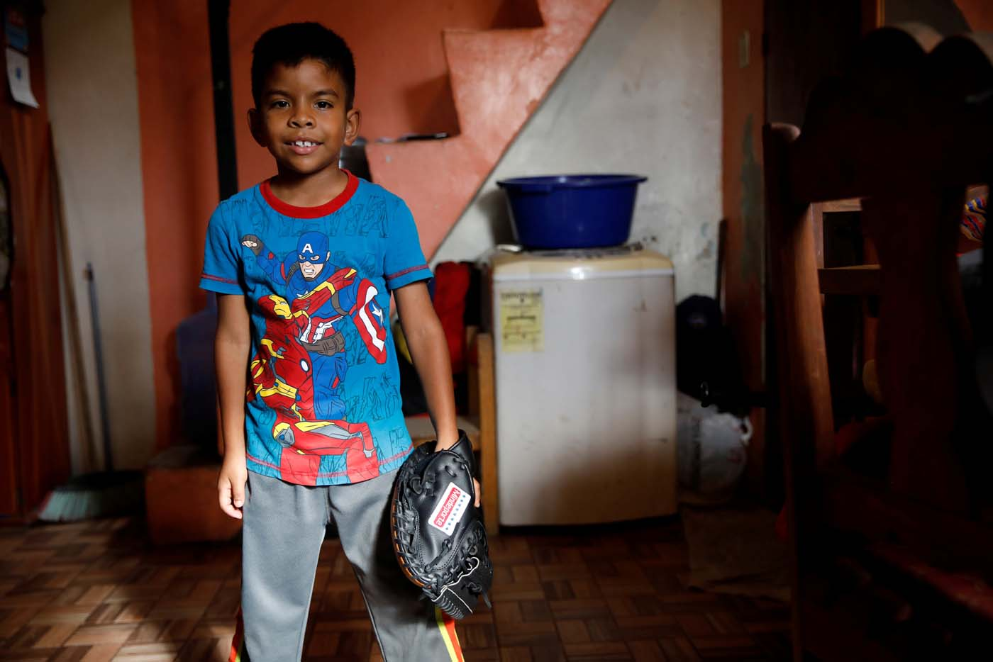 Jesus Cordova (7), poses for a picture in his house in Caracas, Venezuela August 29, 2017. Picture taken August 29, 2017. REUTERS/Carlos Garcia Rawlins