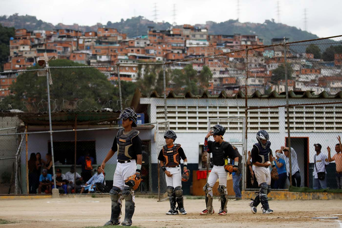 Rivaldo Avila (L) and teammates take part in a baseball showcase in Caracas, Venezuela August 25, 2017. Picture taken August 25, 2017. REUTERS/Carlos Garcia Rawlins