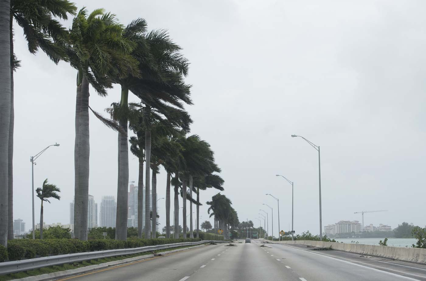A main street leading to Miami Beach is nearly deserted as outer bands of Hurricane Irma arrive in Miami Beach, Florida, September 9, 2017. Hurricane Irma weakened slightly to a Category 4 storm early Saturday, according to the US National Hurricane Center, after making landfall hours earlier in Cuba with maximum-strength Category 5 winds. / AFP PHOTO / SAUL LOEB