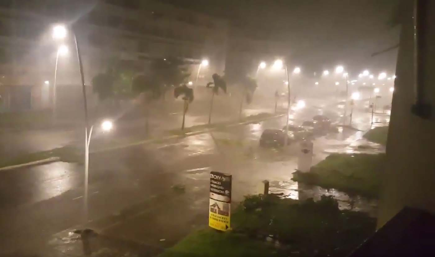 "This handout picture obtained from a video released on September 19, 2017, on the Twitter account of Yves Thole shows powerful winds and rain of hurricane Maria battering a street of Pointe-a-Pitre on the French overseas Caribbean island of Guadeloupe. Hurricane Maria strengthened into a ""potentially catastrophic"" Category Five storm as it barrelled into eastern Caribbean islands still reeling from Irma, forcing residents to evacuate in powerful winds and lashing rain. / AFP PHOTO / TWITTER / Yves THOLE / RESTRICTED TO EDITORIAL USE - MANDATORY CREDIT ""AFP PHOTO / TWITTER / YVES THOLE"" - NO MARKETING NO ADVERTISING CAMPAIGNS - DISTRIBUTED AS A SERVICE TO CLIENTS"