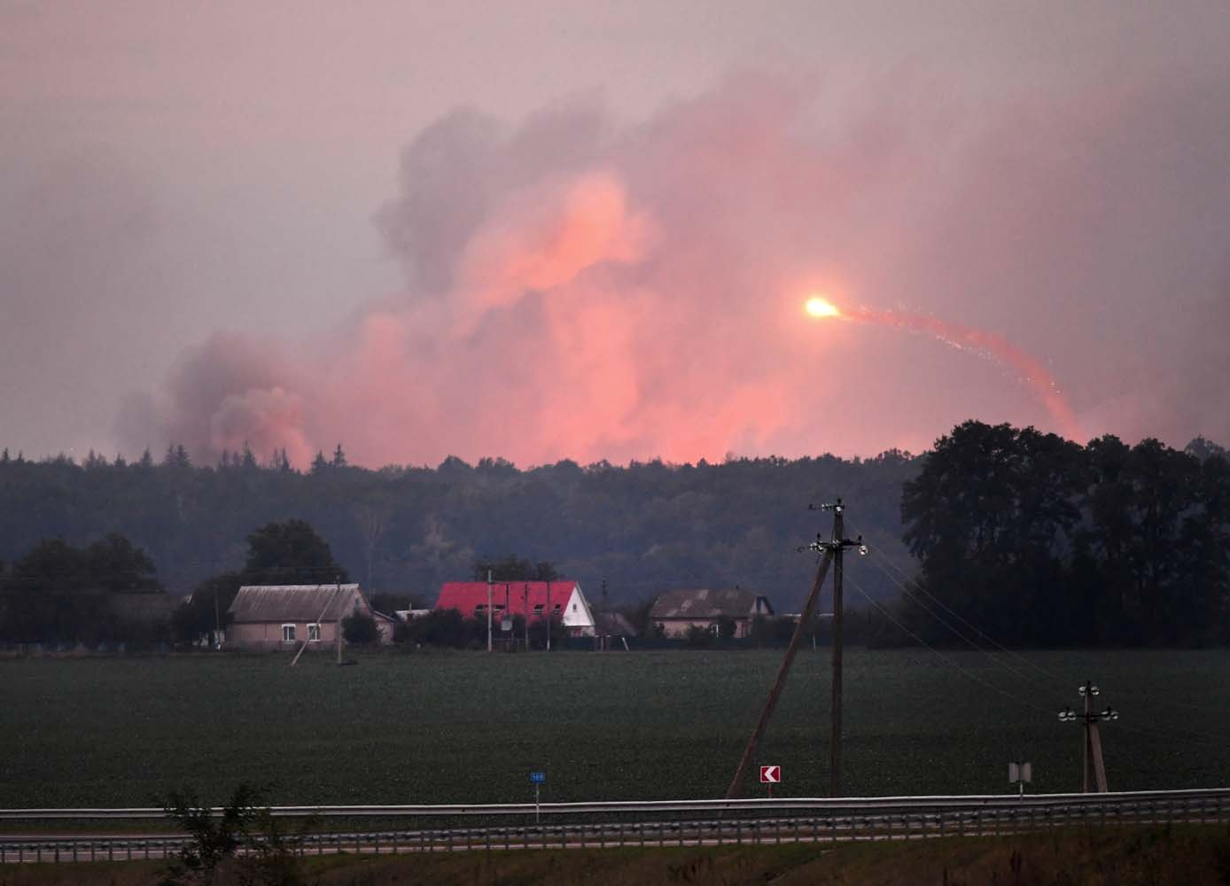 "This photo taken on September 27, 2017 near Kalynivka shows explosions at a military munitions depot. Ukranian authorities evacuated nearly 30,000 people September 27 from the central Vinnytsya region after a huge munitions depot caught fire and set off artillery shells and blasts prosecutors were treating as an act of ""sabotage"". It was the second major incident affecting a Ukrainian weapons storage site this year. Kiev blamed the first one in March on Moscow and its Russian-backed insurgents fighting Ukrainian forces in the war-wrecked east -- a charge both sides denied. / AFP PHOTO / Sergei SUPINSKY"