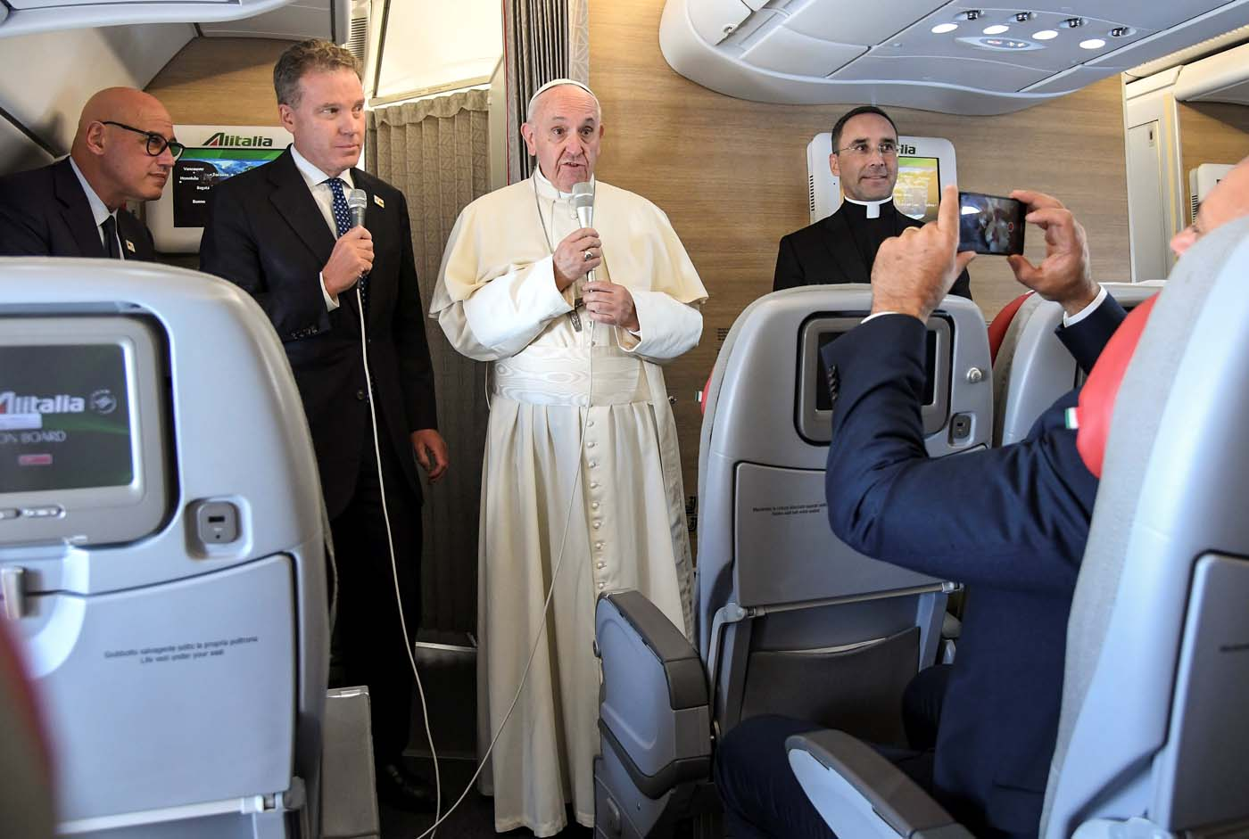 Pope Francis talks aboard a plane for his 5-days pastoral visit to Colombia at Fiumicino international airport in Rome, Italy, September 6, 2017. REUTERS/Alessandro Di Meo/Pool