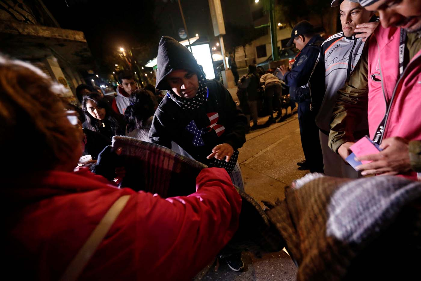 People gather on a street as they receive blankets after an earthquake hit Mexico City, Mexico, September 8, 2017. REUTERS/Edgard Garrido