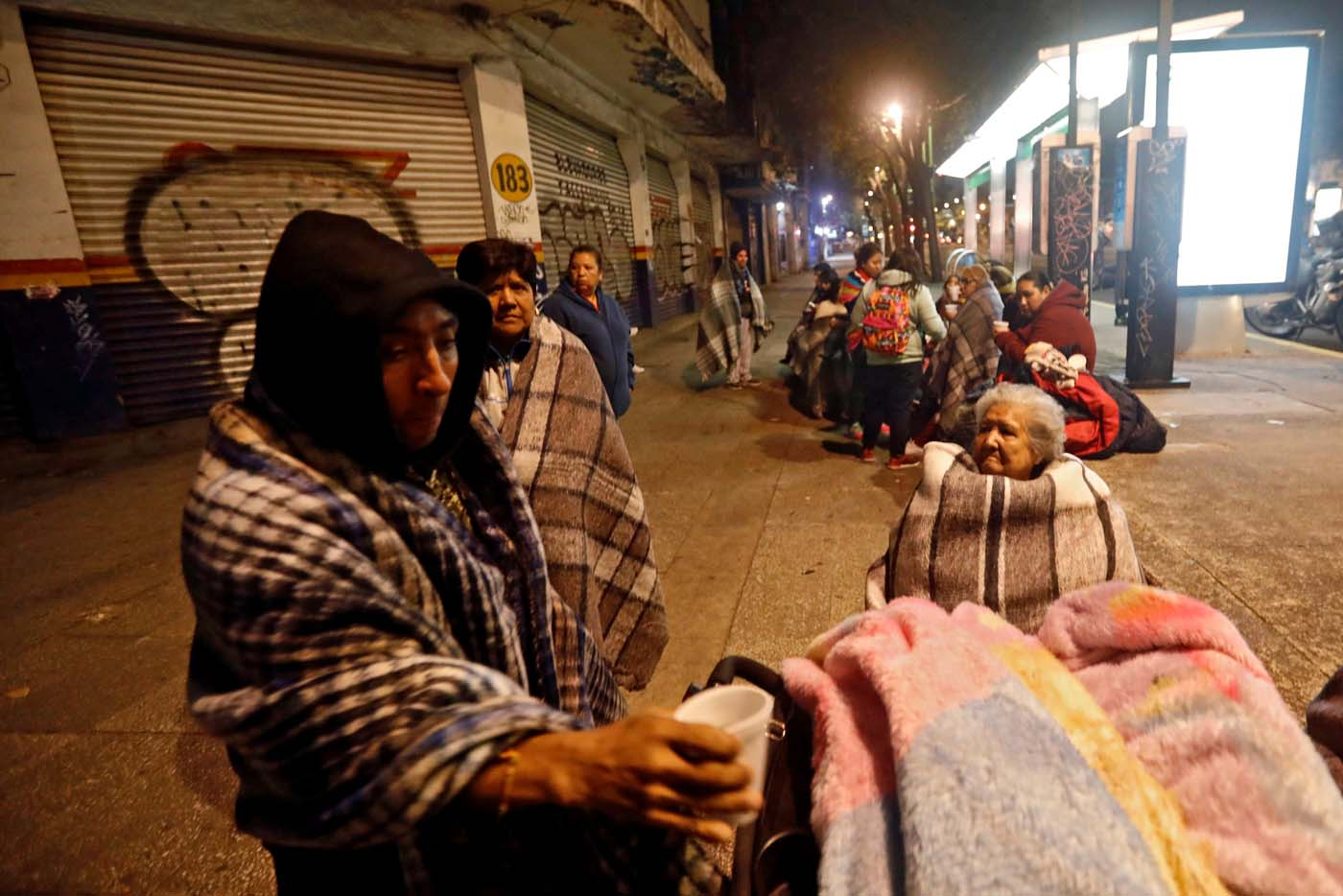 People gather on a street after an earthquake hit Mexico City, Mexico, September 8, 2017. REUTERS/Edgard Garrido