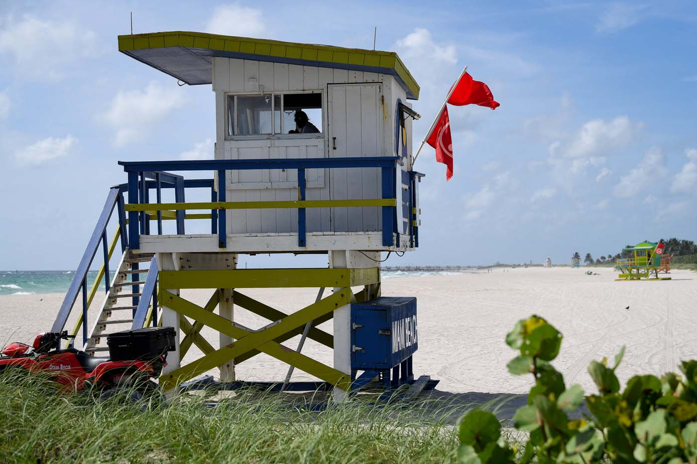 A lifeguard in beach patrol tower keeps watch along a stretch of the beach in Miami Beach, Florida, U.S., September 8, 2017. REUTERS/Bryan Woolston