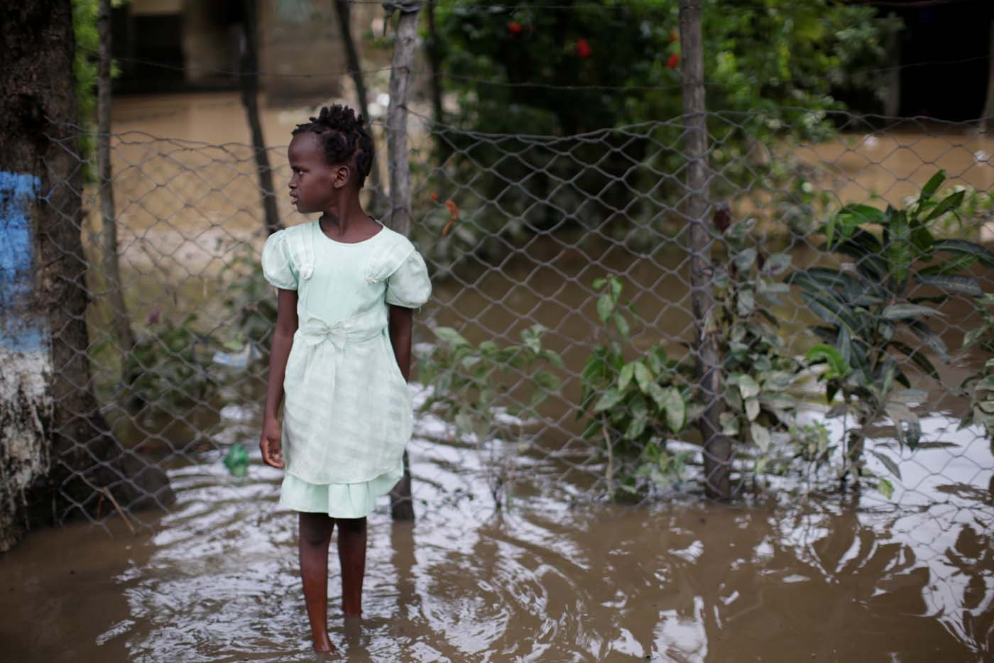 A girl stands in a flooded area after hurricane Irma in Fort Liberte, Haiti September 8, 2017. REUTERS/Andres Martinez Casares