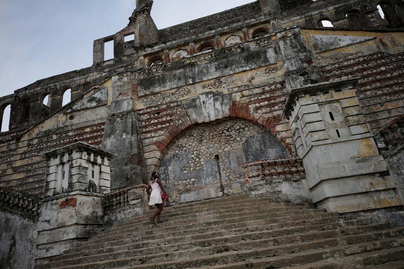 A woman climbs the stairs on the remains of Sans-Souci Palace in Milot, Haiti, September 8, 2017. REUTERS/Andres Martinez Casares