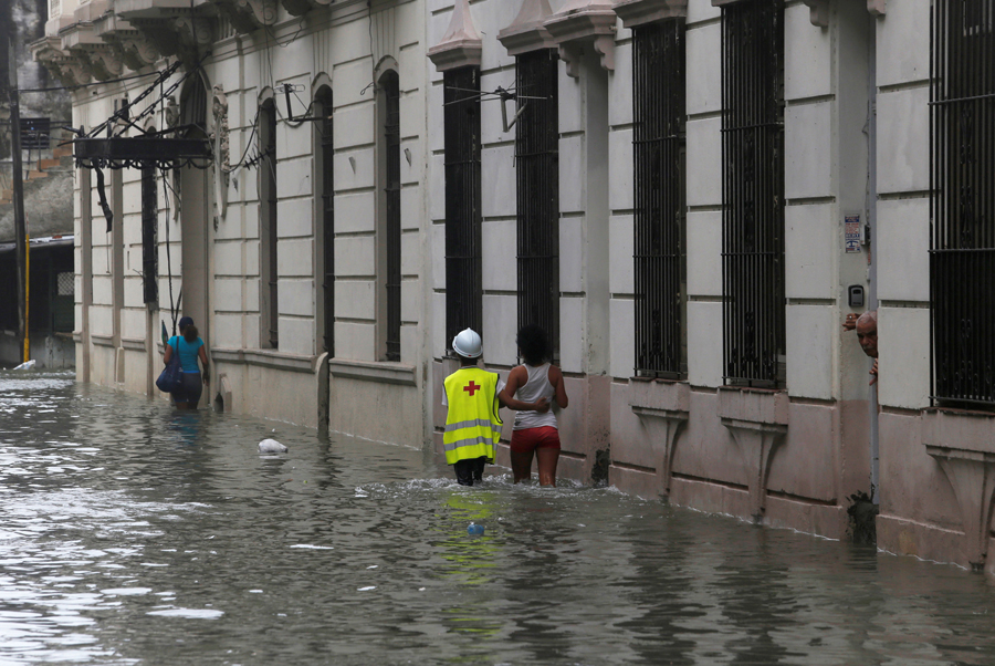 People wade through a flooded street after the passing of Hurricane Irma, in Havana, Cuba, September 10, 2017. REUTERS/Stringer NO SALES. NO ARCHIVES