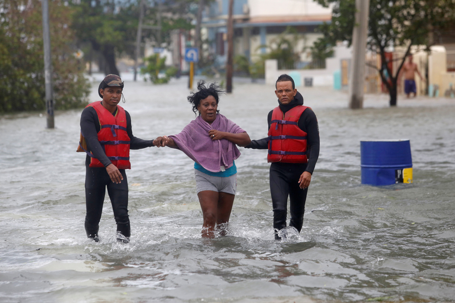 Rescue personnel help a woman after the passing of Hurricane Irma, in Havana, Cuba, September 10, 2017. REUTERS/Stringer NO SALES. NO ARCHIVES