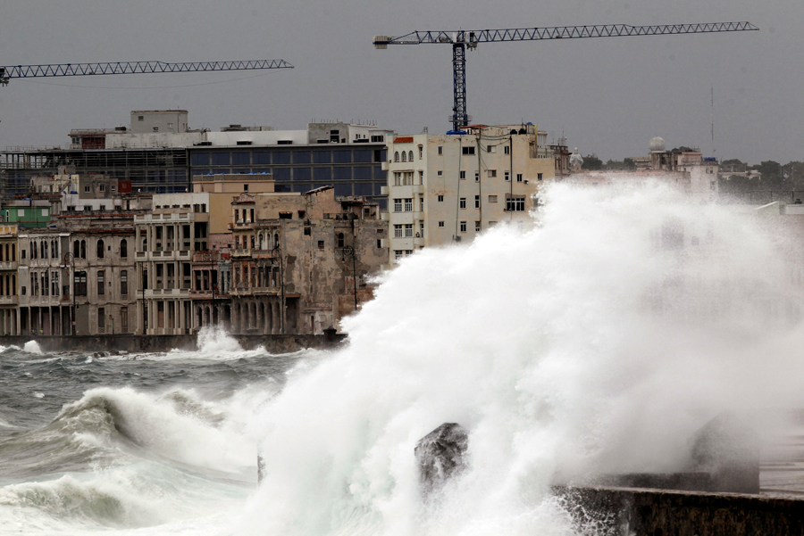 FILE PHOTO: Waves crash against the seafront boulevard El Malecon ahead of the passing of Hurricane Irma, in Havana, Cuba September 9, 2017. REUTERS/Stringer  NO SALES. NO ARCHIVES/File Photo