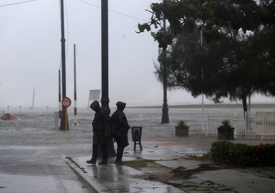 Police stand guard near the flooded seafront boulevard El Malecon, after the passing of Hurricane Irma, in Havana, Cuba, September 10, 2017. REUTERS/Stringer NO SALES. NO ARCHIVES