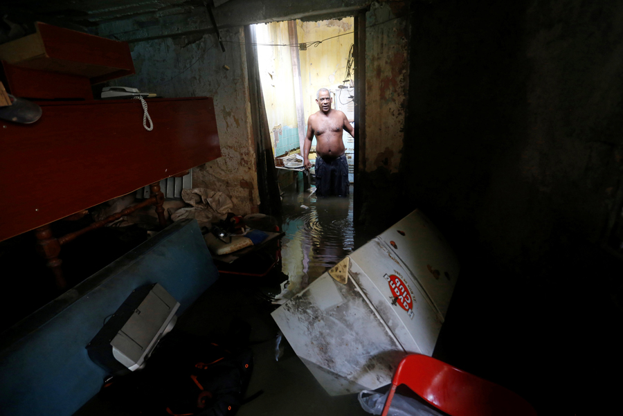 A man stands in his flooded home after the passing of Hurricane Irma in Havana, Cuba, September 10, 2017. REUTERS/Stringer NO SALES. NO ARCHIVES