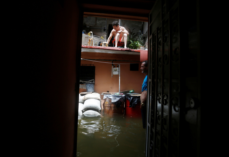 A man stands in the flooded passage of a block of flats after the passing of Hurricane Irma in Havana, Cuba, September 10, 2017. REUTERS/Stringer NO SALES. NO ARCHIVES