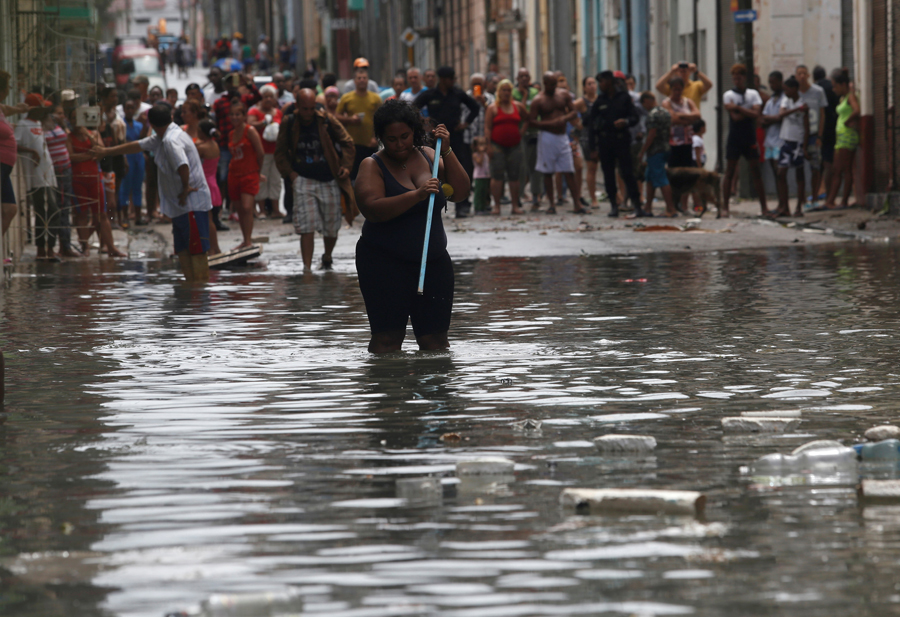 A woman wades through the water after the passing of Hurricane Irma, in Havana, Cuba September 10, 2017. REUTERS/Stringer NO SALES. NO ARCHIVES