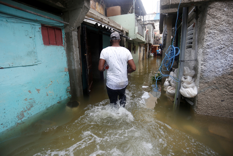 A man walks through the flooded passage of a block of flats, after the passing of Hurricane Irma, in Havana, Cuba September 10, 2017. REUTERS/Stringer NO SALES. NO ARCHIVES