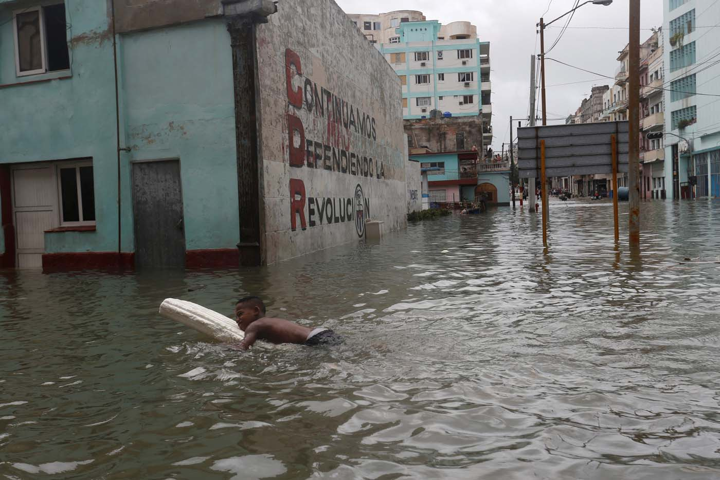 A boy floats with a foam board in a flooded street, after the passing of Hurricane Irma, in Havana, Cuba September 10, 2017. REUTERS/Stringer NO SALES. NO ARCHIVES