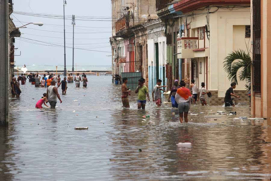 People wade through a flooded street, after the passing of Hurricane Irma, in Havana, Cuba September 10, 2017. REUTERS/Stringer NO SALES. NO ARCHIVES