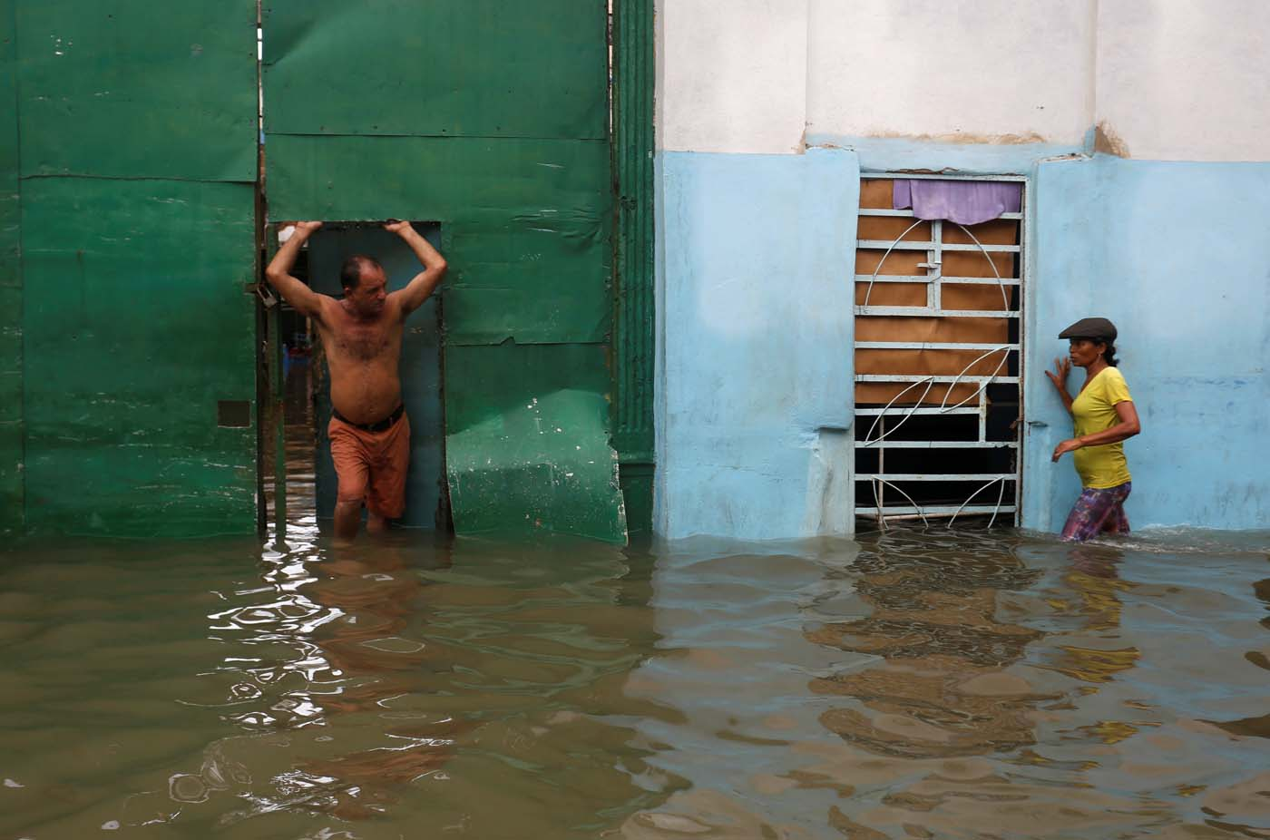 People are seen in a flooded street, after the passing of Hurricane Irma, in Havana, Cuba September 10, 2017. REUTERS/Stringer NO SALES. NO ARCHIVES