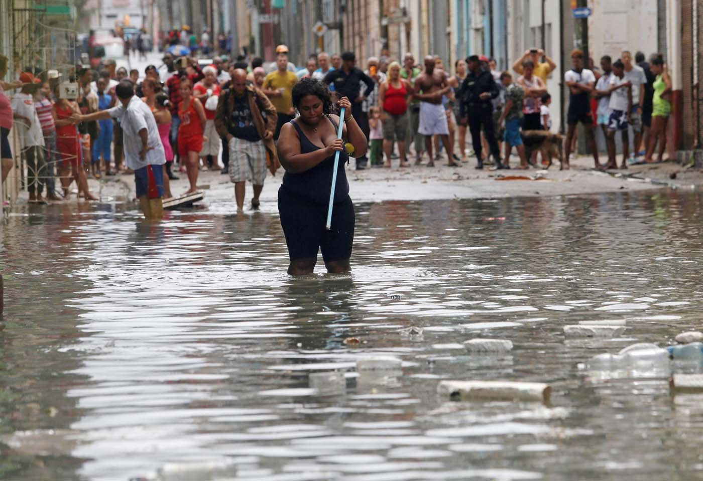 REFILE - QUALITY REPEAT A woman wades through the water after the passing of Hurricane Irma, in Havana, Cuba September 10, 2017. REUTERS/Stringer NO SALES. NO ARCHIVES
