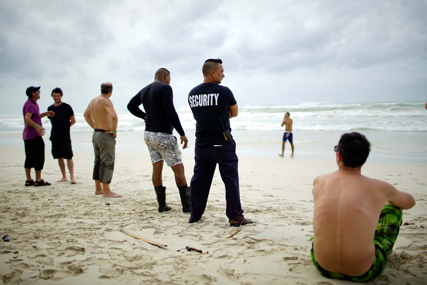 Tourists and a security agent are seen on a beach a day after the passage of Hurricane Irma in Varadero, Cuba, September 10, 2017. REUTERS/Alexandre Meneghini
