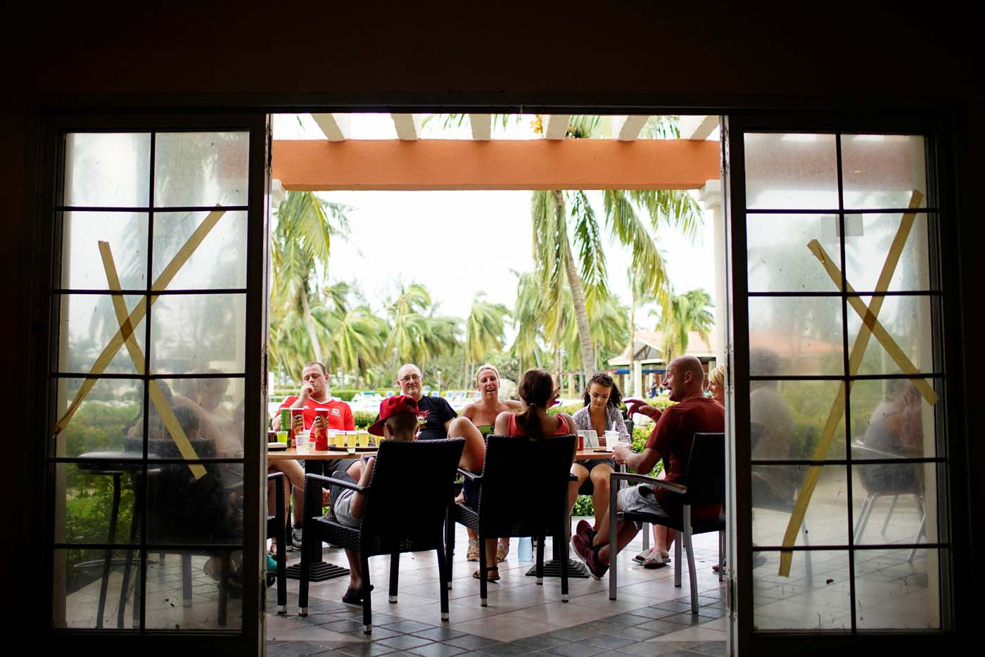 Tourists from England and Scotland have drinks in a hotel a day after the passage of Hurricane Irma in Varadero, Cuba, September 10, 2017. REUTERS/Alexandre Meneghini