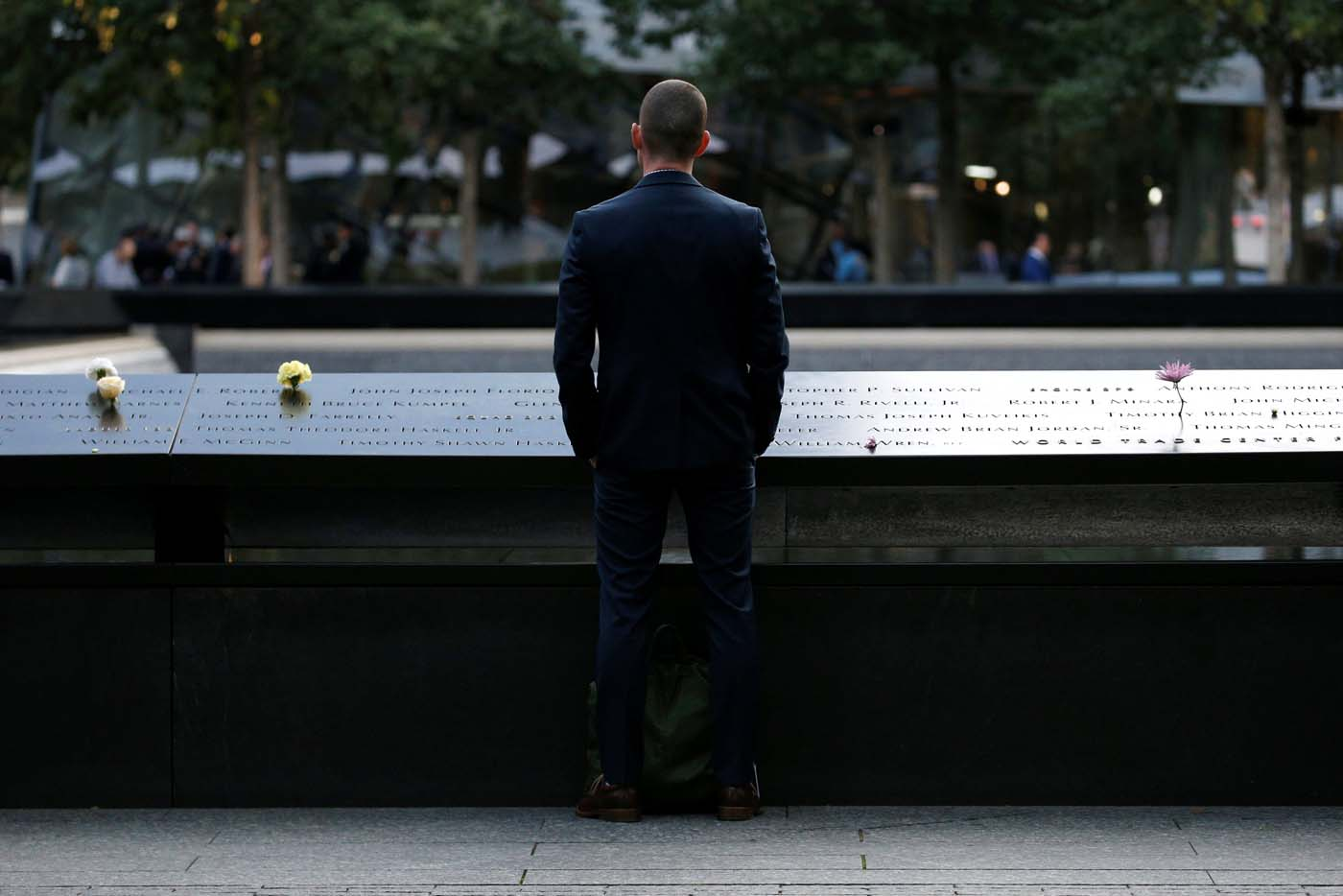 A man pauses at the edge of the South reflecting pool at the National September 11 Memorial and Museum during ceremonies marking the 16th anniversary of the September 11, 2001 attacks in New York, U.S, September 11, 2017. REUTERS/Brendan McDermid