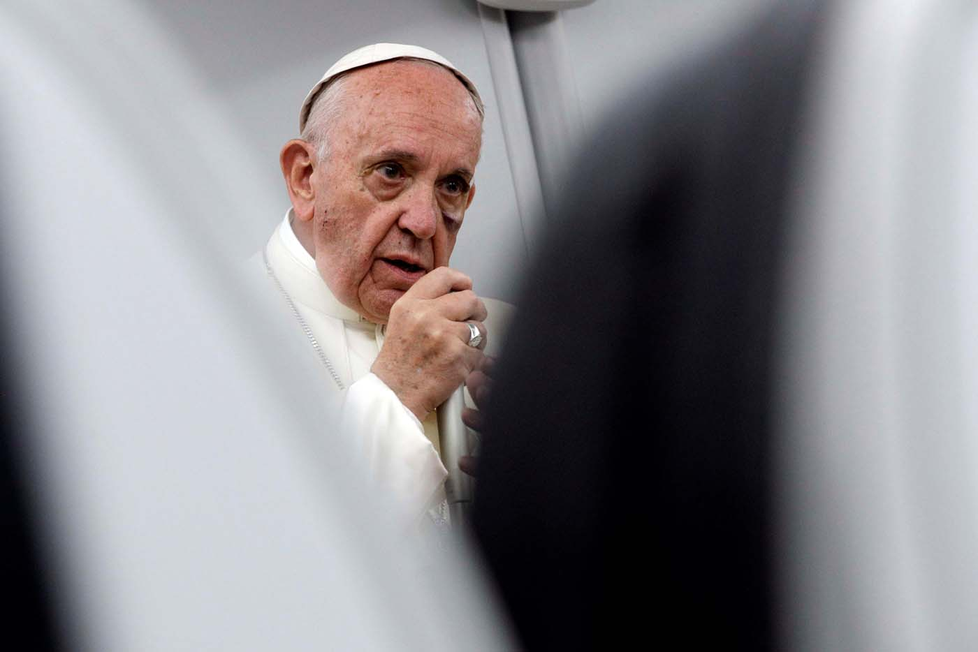 Pope Francis talks to journalists during a press conference aboard a plane flight to Rome at the end of his visit to Colombia, September 11, 2017. REUTERS/Andrew Medichini/Pool