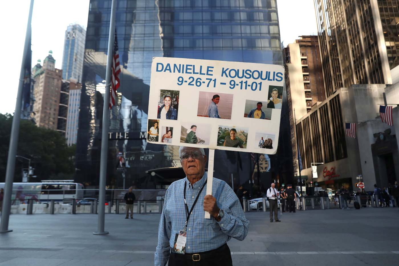 George Kousoulis holds a sign with images of his late daughter Danielle Kousoulis who was killed in the September 11, 2001 attacks in New York near the National September 11 Memorial and Museum on the 16th anniversary of the attacks in New York, U.S. September 11, 2017. REUTERS/Shannon Stapleton