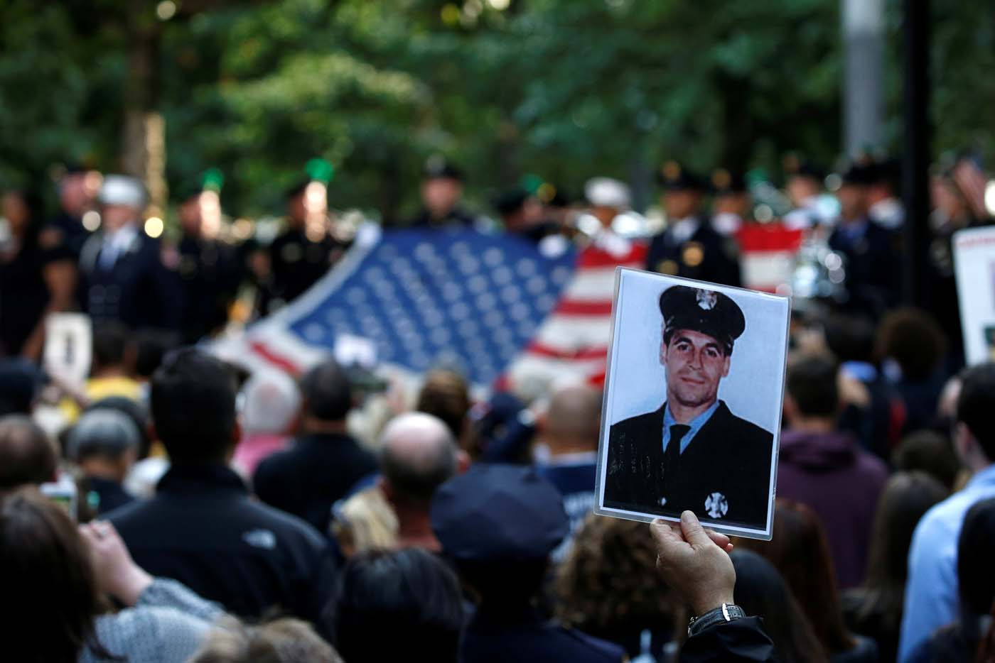 A person holds up a photograph of a victim at the National September 11 Memorial and Museum during ceremonies marking the 16th anniversary of the September 11, 2001 attacks in New York, U.S. September 11, 2017. REUTERS/Brendan McDermid