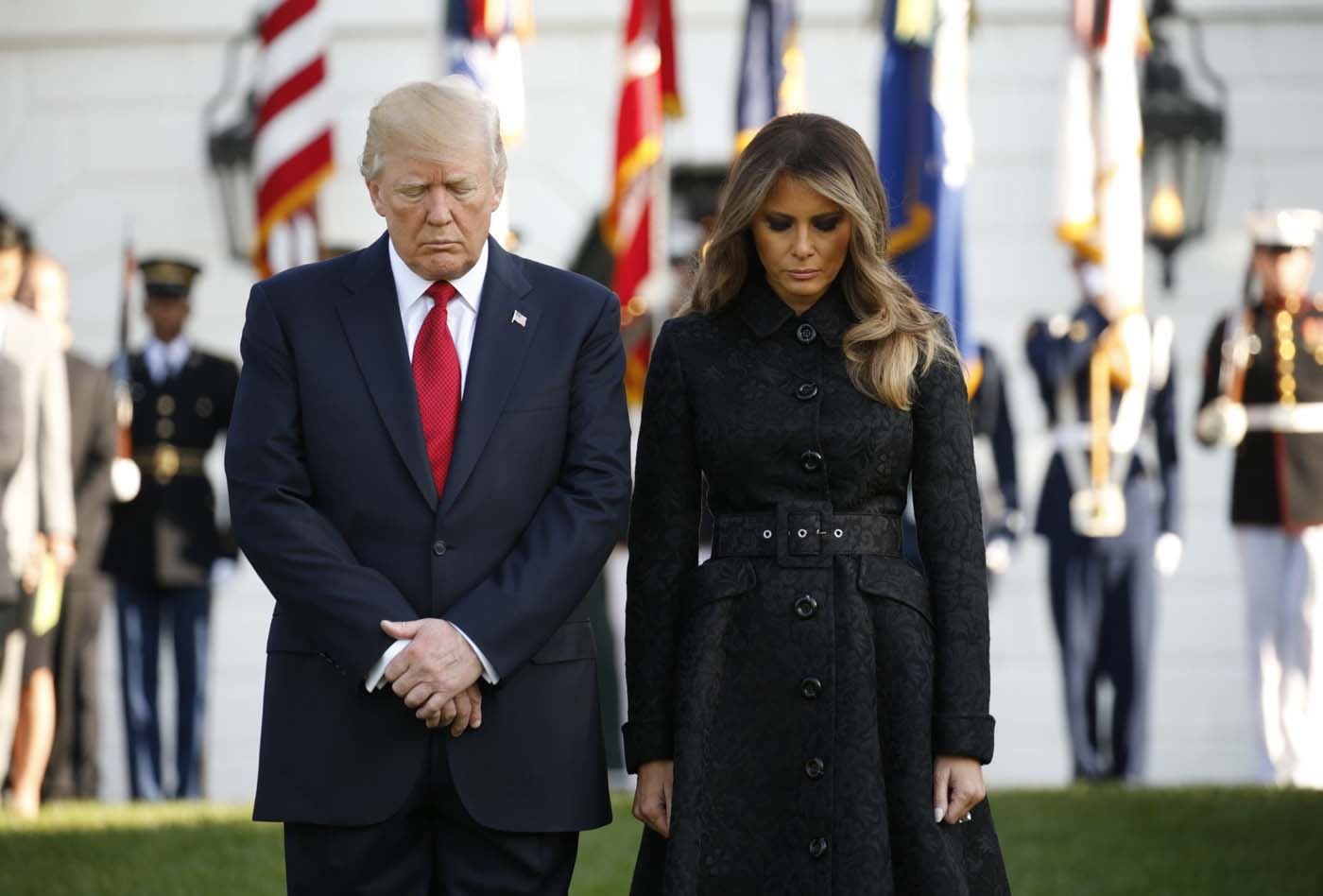 U.S. President Donald Trump and first lady Melania Trump lead a moment of silence to mark the 16th anniversary of the September 11 attacks at the White House in Washington, U.S., September 11, 2017. REUTERS/Kevin Lamarque