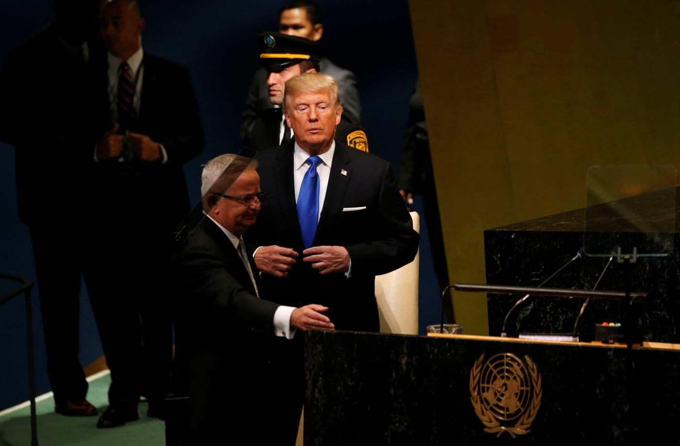 U.S. President Donald Trump steps up to deliver his address to the United Nations General Assembly in New York, U.S., September 19, 2017. REUTERS/Kevin Lamarque