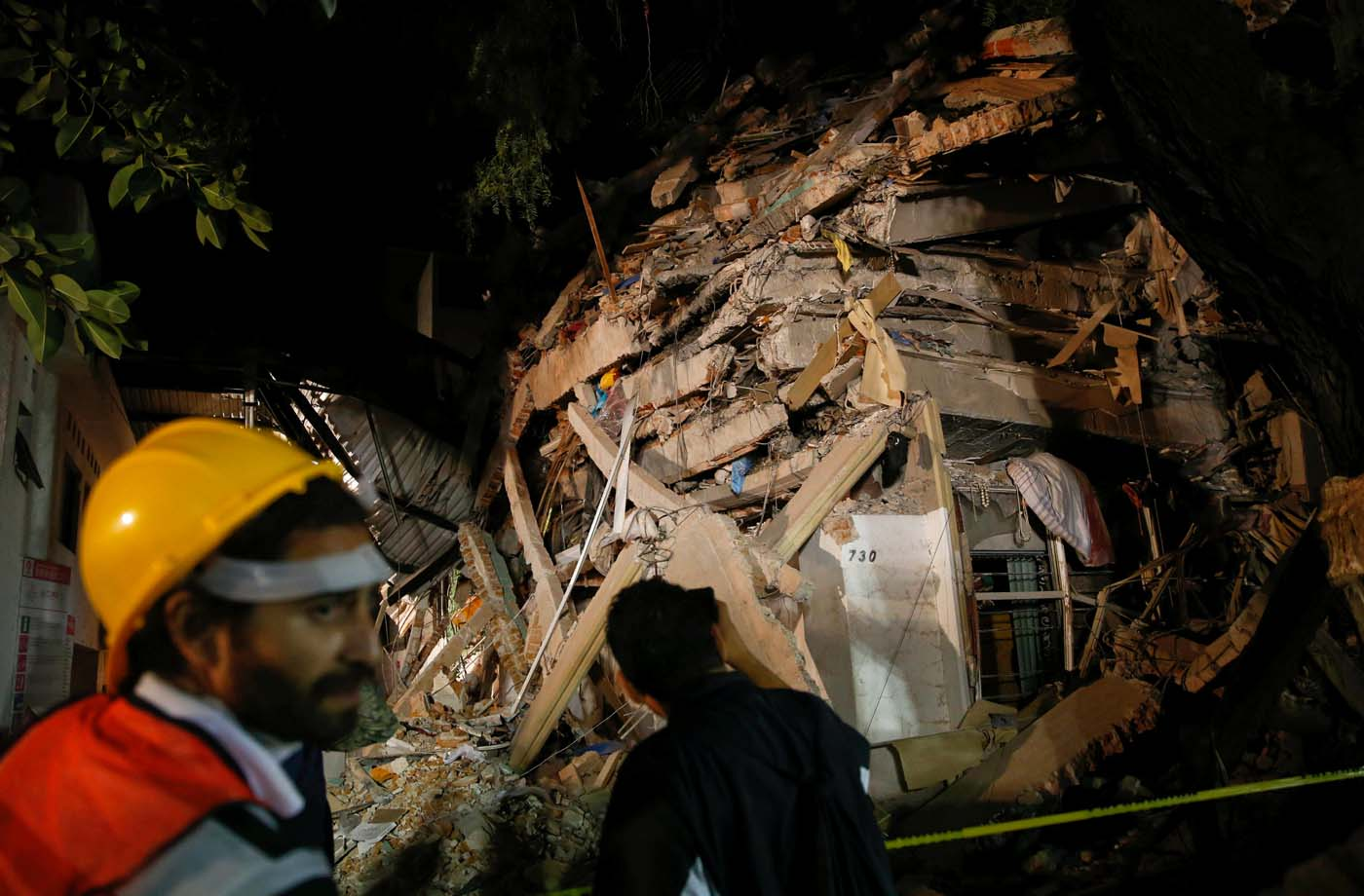 A rescuer walks past at a collapsed building after an earthquake in Mexico City, Mexico September 20, 2017. REUTERS/Henry Romero