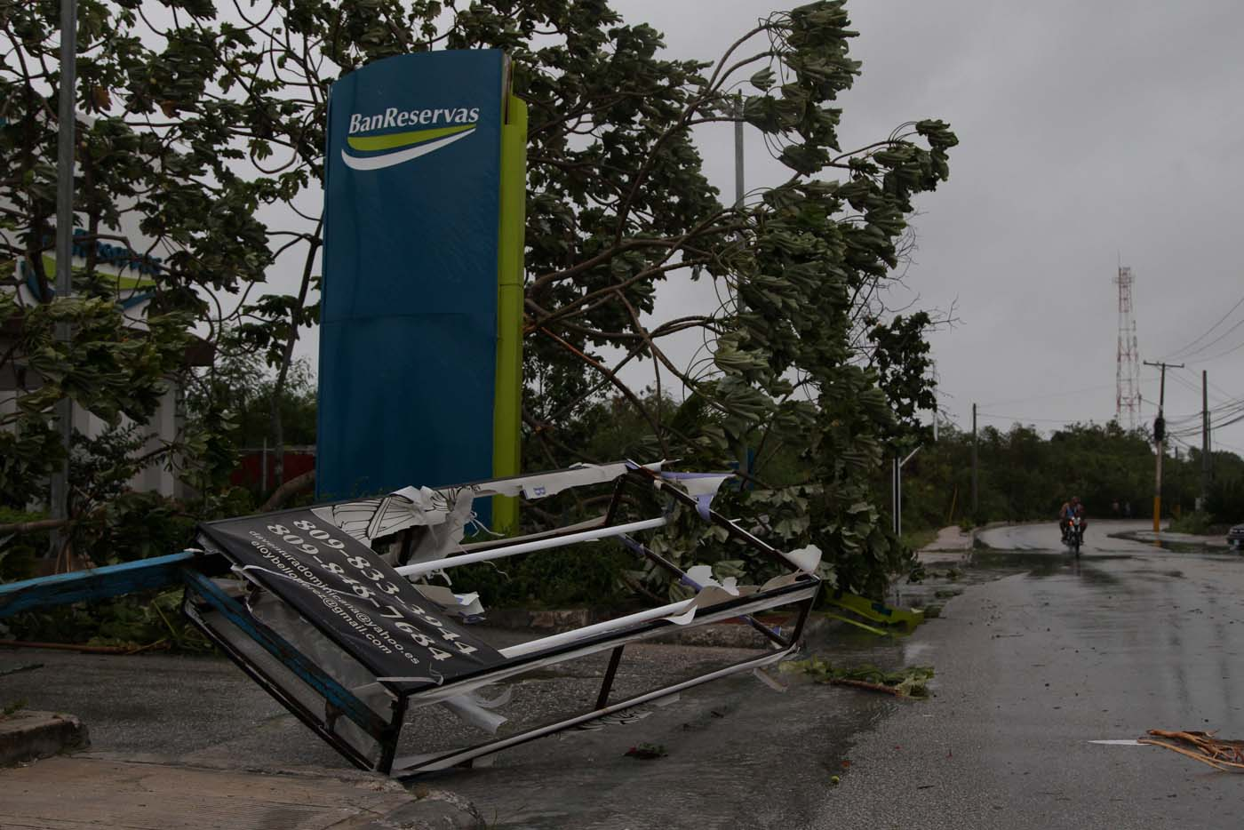 A man rides a motorbike on the street before the arrival of the Hurricane Maria in Punta Cana, Dominican Republic, September 20, 2017. REUTERS/Ricardo Rojas