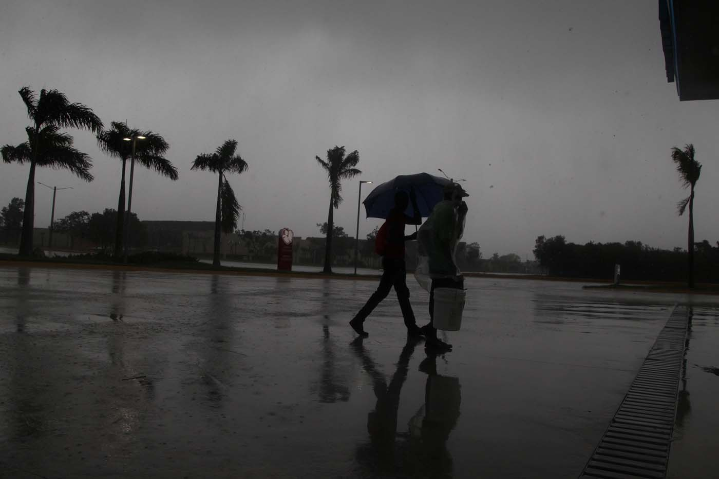 People walk before the arrival of Hurricane Maria in Punta Cana, Dominican Republic, September 20, 2017. REUTERS/Ricardo Rojas