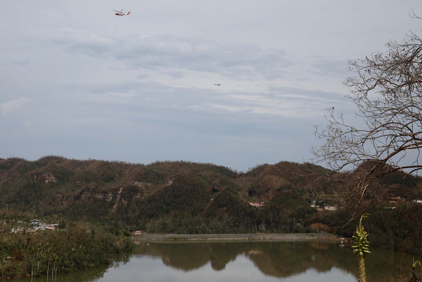 U.S. Coast Guard helicopters fly over the dam at the Guajataca lake after the area was hit by Hurricane Maria in Guajataca, Puerto Rico September 23, 2017. REUTERS/Carlos Garcia Rawlins
