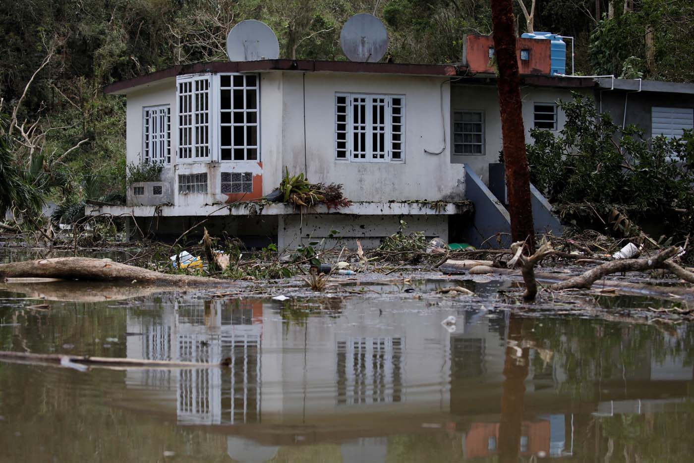 A house submerged by flood waters is seen close to the dam of the Guajataca lake after the area was hit by Hurricane Maria in Guajataca, Puerto Rico September 23, 2017. REUTERS/Carlos Garcia Rawlins