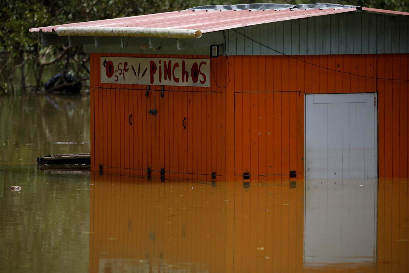 A restaurant submerged by flood waters is seen close to the dam of the Guajataca lake after the area was hit by Hurricane Maria in Guajataca, Puerto Rico September 23, 2017. REUTERS/Carlos Garcia Rawlins