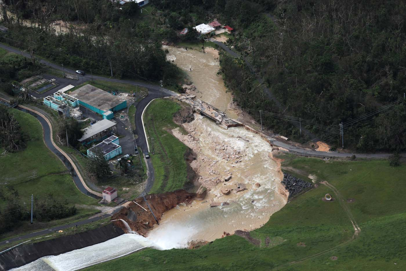 An aerial view shows the damage to the Guajataca dam in the aftermath of Hurricane Maria, in Quebradillas, Puerto Rico September 23, 2017. REUTERS/Alvin Baez