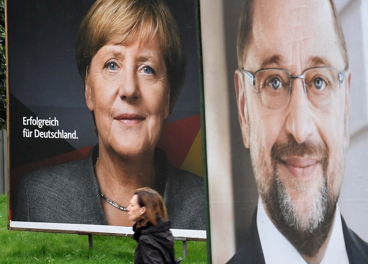 Election posters of German Chancellor Angela Merkel of the Christian Democratic Party CDU and Social Democratic Party SPD leader and top candidate Martin Schulz are seen in Hamburg, Germany, September 24, 2017. REUTERS/Fabian Bimmer
