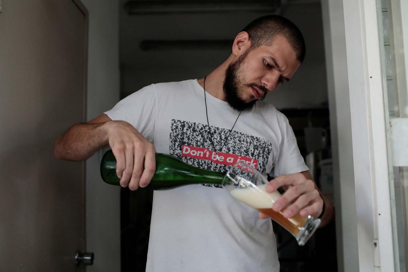 Francisco Lopez serves craft beer at Cerveza Caleta brewery in Caracas, Venezuela, September 13, 2017. Picture taken September 13, 2017. REUTERS/Marco Bello